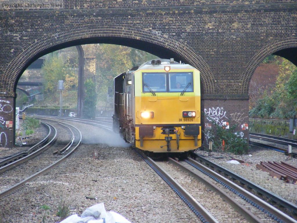 A Network Rail MUV on sandite duties at Putney