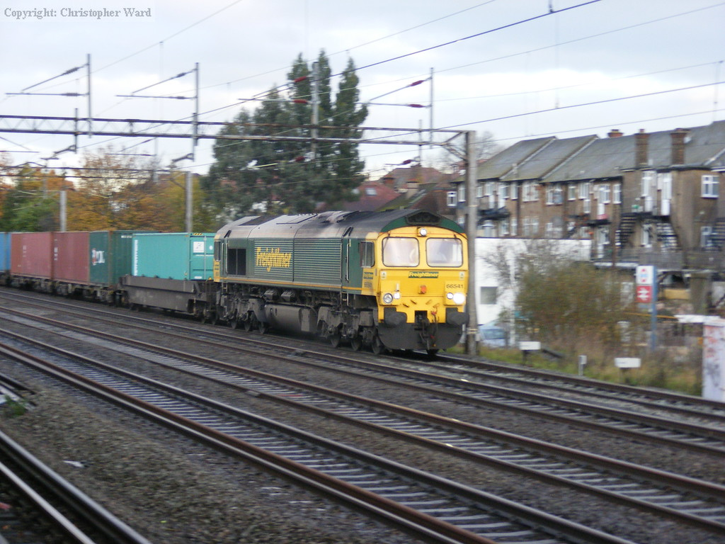 A Freightliner working roars south