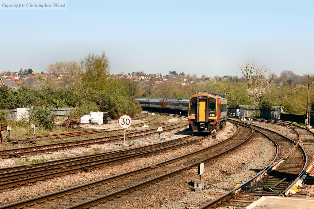 The Exeter / Westbury to Waterloo train disappears round the bend