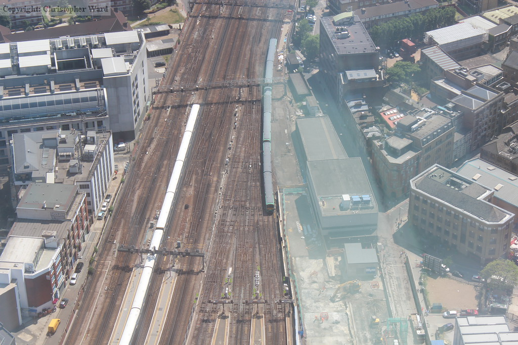 Class 456 and class 465 units pass in the throat of London Bridge