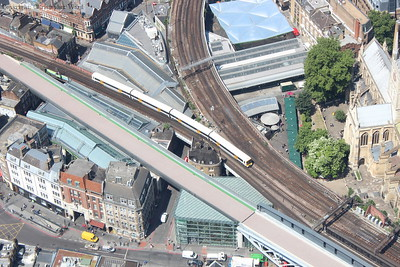 A four car Networker passes Borough Market Junction