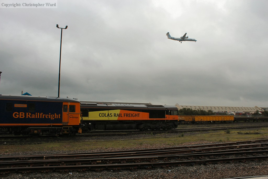 A plane flies low over the yard on the way into Southampton airport