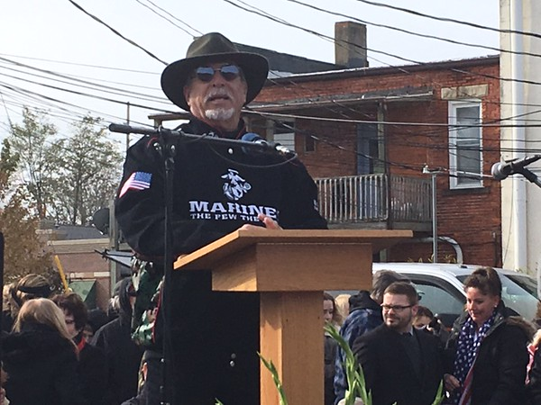 """. Kevin Martin �The Morning Journal <br>  Larry Giese addresses the crowd at Amherst\'s Veteran\'s Day celebrations at 248 Park Ave. on Nov. 11. Giese\'s son Ryan \""""Goose\"""" Giese was among ten fallen U.S. servicemen in Iraq and Afghanistan who were honored in a mural created by Amherst artists Mike Sekletar and Brian Goodwin which was unveiled."""