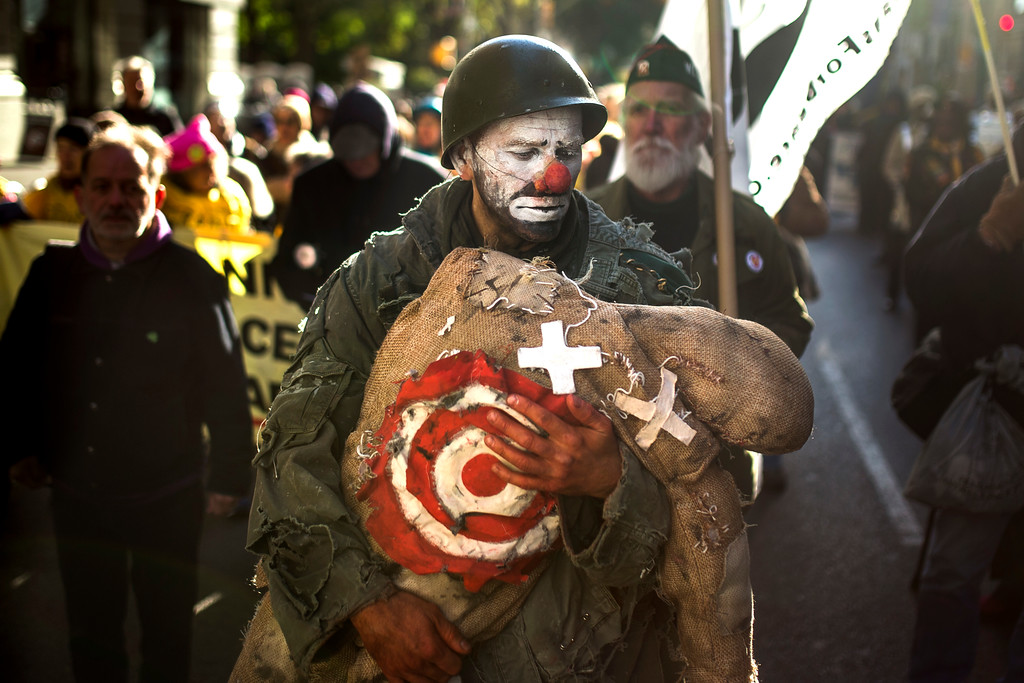 . A member of Veterans for Peace performs as he marches during the annual Veterans Day parade in New York, Saturday, Nov. 11, 2017. (AP Photo/Andres Kudacki)
