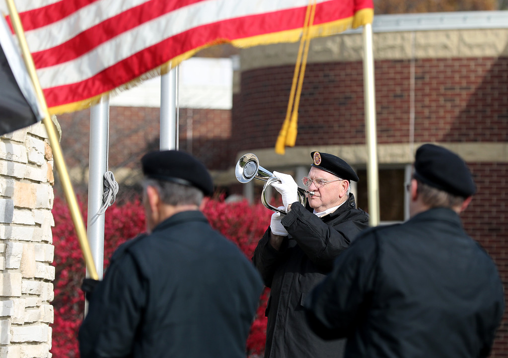 . Jonathan Tressler - The News-Herald <br>  Mentor Veterans of Foreign Wars Post 9295 plays Taps on his trumpet Nov. 11 during Mentor\'s Veterans Day ceremony at the city\'s Veterans Memorial.