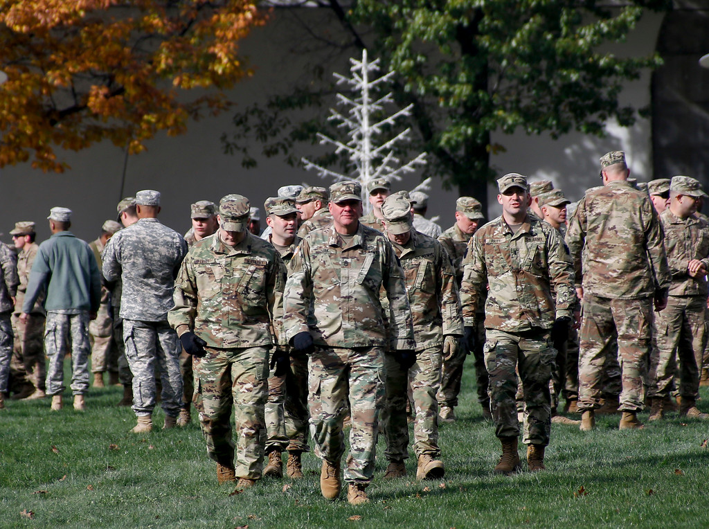 . Army veterans gather with currently serving soldiers in Point State Park as part of the Steel City Supports the Troops event to honor Veterans Day, Saturday, Nov. 11, 2017, in Pittsburgh. (AP Photo/Keith Srakocic)