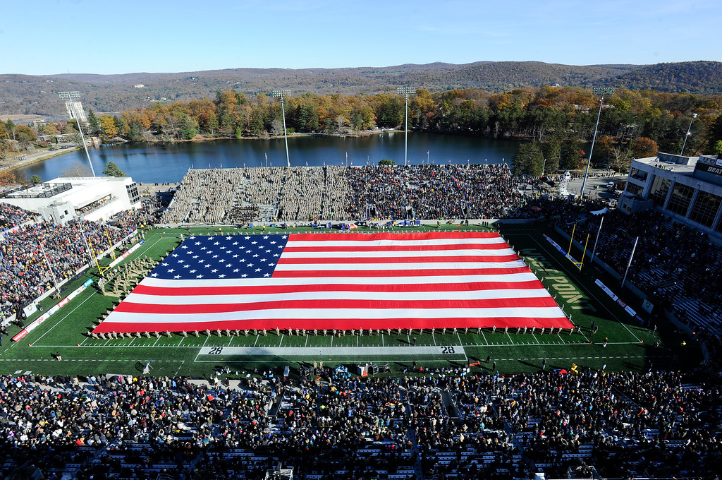 . The American Flag is displayed during halftime of an NCAA college football game between Army and Duke honoring all that served in the armed forces on Veterans Day, Saturday, Nov. 11, 2017, in West Point, N.Y. (AP Photo/Hans Pennink)