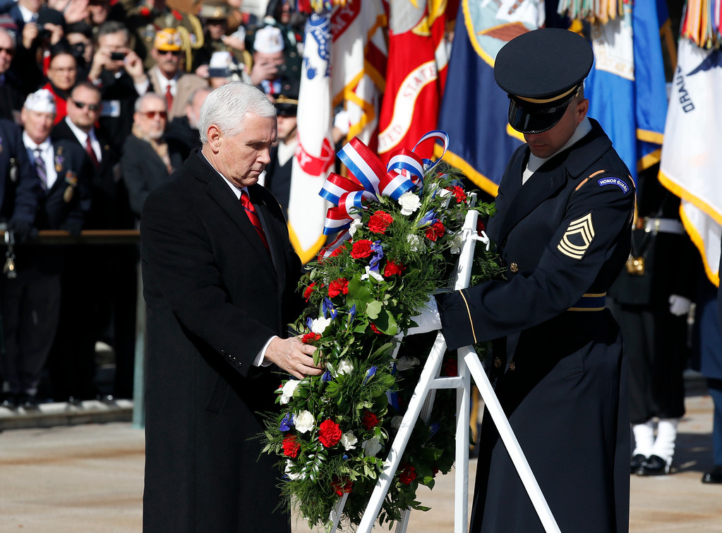 . Vice President Mike Pence places a wreath at the Tomb of the Unknown Soldier during a ceremony at Arlington National Cemetery on Veterans Day, Saturday, Nov. 11, 2017 in Washington. (AP Photo/Alex Brandon)