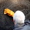Vice President Mike Pence cleans a portion of the wall at the Vietnam Veterans Memorial on Veterans Day, Saturday, Nov. 11, 2017 in Washington. (AP Photo/Alex Brandon)