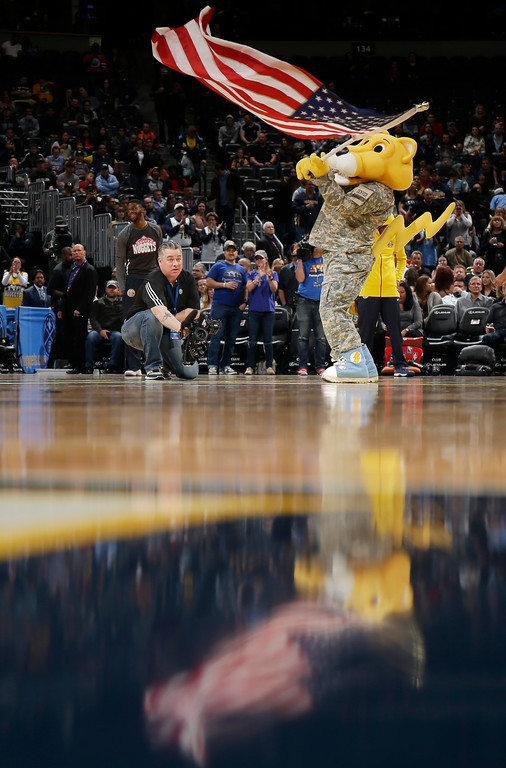 . Denver Nuggets mascot Rocky waves a United States flag to celebrate Veterans Day during the first quarter of an NBA basketball game against the Orlando Magic, Saturday, Nov. 11, 2017, in Denver. (Photo by Jack Dempsey)