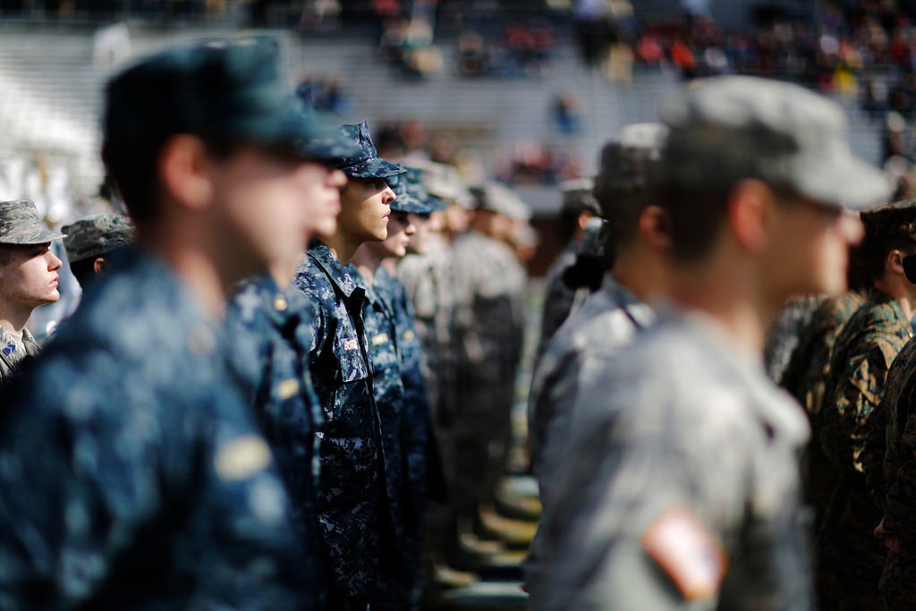 . Members of the Georgia Tech ROTC take the field before the playing of the national anthem on Veterans Day at an NCAA college football game between Georgia Tech and Virginia Tech in Atlanta, Saturday, Nov. 11, 2017. (AP Photo/David Goldman)