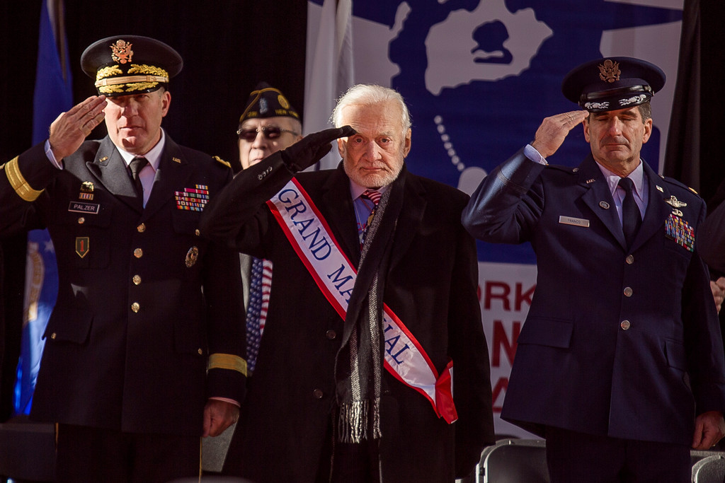 . Former astronaut Buzz Aldrin, center,salutes during the annual Veterans Day parade in New York, Saturday, Nov. 11, 2017. Aldrin served as Grand Marshal as he joined Mayor Bill de Blasio and others at the city\'s parade. (AP Photo/Andres Kudacki)