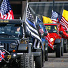 Various styles of American flags adorn a column of Jeeps participating in the Veterans Day parade in downtown Pittsburgh, Saturday, Nov. 11, 2017. (AP Photo/Keith Srakocic)