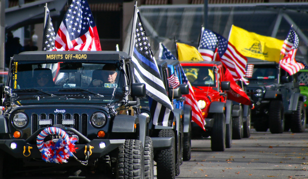 . Various styles of American flags adorn a column of Jeeps participating in the Veterans Day parade in downtown Pittsburgh, Saturday, Nov. 11, 2017. (AP Photo/Keith Srakocic)