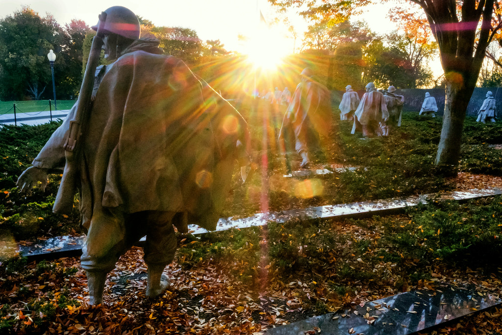 . The early morning sun streaks through the trees at the Korean War Veterans Memorial in Washington on Veterans Day, Saturday Nov. 11, 2017. (AP Photo/J. David Ake)