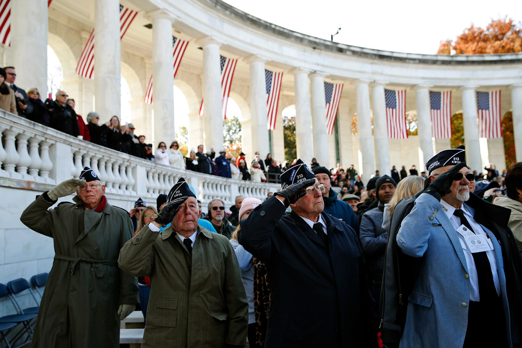 . CORRECTS MISSPELLED - Veterans salute as the colors are presented before Vice President Mike Pence speaks during a Veterans Day ceremony at Arlington National Cemetery, Saturday, Nov. 11, 2017 in Washington. (AP Photo/Alex Brandon)