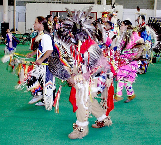 Dancing within the circle. The Pow Wow is a family activity. Visitors are invited into the dance circle at approriate times during the Pow Wow. Obviously a very colorful event, photos can not convey the singing and drumming excitment of the Pow Wow. You have to experience one!!