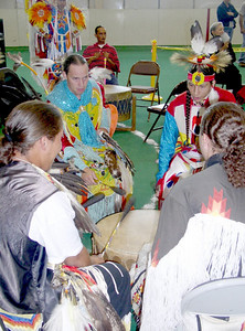 Drummers. Drumming is usually an elder activity and the drummers also sing or chant while drumming. Some younger Natives, honoring their Native heritage by learning from elders are seen drumming here.