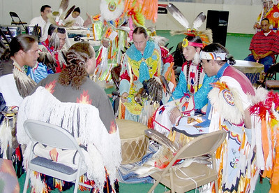 Pow Wow drum  and drummers / singers. The Pow Wow leader narrates the activity between dances and calls the dancers into the circle for the next dance. The leader provides important information for non-Natives on what is proper conduct during the Pow Wow.