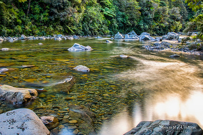 Beautiful clean and clear Pakuratahi river flowing through Kaitoki Regional Park