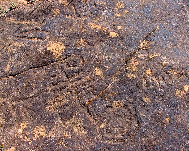 6,000 year old petroglyphs recently uncovered near Santa Fe.