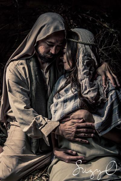 Joseph comforting Mary