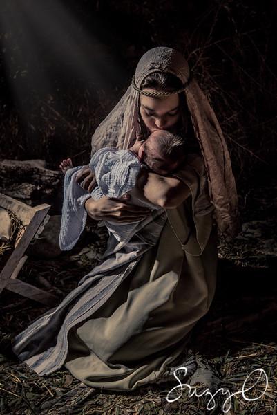 Mary kisses baby Jesus