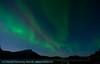 Nordlys på sør-østhimmelen, Efjord, 8.10.2011. Til høyre skinner til i husene i Lødingen vestbygd. 1:30 min eksponeringstid.