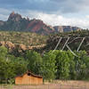 Red Barn set against a forest and the Red Rocks of Utah