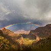 A stunning rainbow arcs over the Grand Canyon.