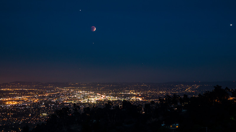 A rare blood moon eclipse over east Los Angeles, CA.