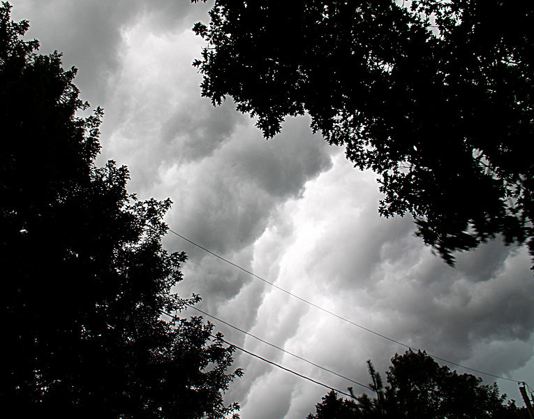 A very fast moving cold front blew through, the clouds changing by the second.  It brought brief but heavy rains to the area.
