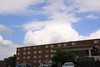 Cumulus clouds in the east building looking over one of the dorms on the UCM campus.