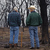 NRCS District Conservationist Tony Dean (right) discuss ranch management options with a Jack County landowner after a wildfire burned through the area three weeks earlier.