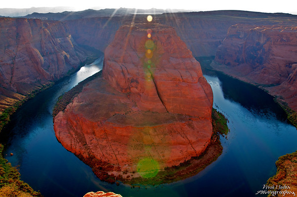 Horseshoe Bend is so named for the natural bend of the Colorado River south of Page, Arizona. This view is taken from 1,000 feet above, and there is no railing to block a fall...