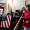 Leominster held its first ever naturalization ceremony on Tuesday, Dec. 17, 2019. 266 individuals became American citizens in a ceremony at City Hall. Chole Iacobacci holds the America flag as she watches the ceremony. Her mom, from Brazil, was swearing in. SENTINEL & ENTERPRISE/JOHN LOVE