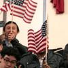Leominster held its first ever naturalization ceremony on Tuesday, Dec. 17, 2019. 266 individuals became American citizens in a ceremony at City Hall. Waving the American flag during he ceremony is Joshua Shanda who's mom, from Haiti, was searing in. SENTINEL & ENTERPRISE/JOHN LOVE