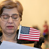 Leominster held its first ever naturalization ceremony on Tuesday, Dec. 17, 2019. 266 individuals became American citizens in a ceremony at City Hall. Reciting the Pledge of Allegiance during the ceremony is Atie Istiefo of Syria, who now lives in Worcester. SENTINEL & ENTERPRISE/JOHN LOVE