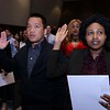 Vandy Ngeth from Cambodia who now lives in Lowell and Jeanne D'arc Kanyange from the Congo who also now lives in Lowell sear in as new citizens during the naturalization ceremony held at the Weston Auditorium at Fitchburg State University Friday, May 4, 2018. SENTINEL & ENTERPRISE/JOHN LOVE