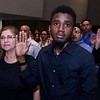 Robby Denaud from Haiti who now lives in Boston swears in as a new citizen during the naturalization ceremony held at the Weston Auditorium at Fitchburg State University Friday, May 4, 2018. SENTINEL & ENTERPRISE/JOHN LOVE