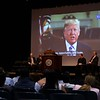 A video message from President Donald Trump was show at the naturalization ceremony held at the Weston Auditorium at Fitchburg State University Friday, May 4, 2018. SENTINEL & ENTERPRISE/JOHN LOVE