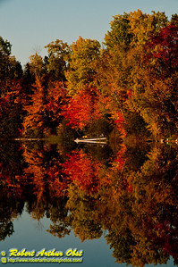 Autumn gorgeous reflections under blue skies over Otter Lake within the Hunting River and Wolf River watershed (USA WI Elcho)