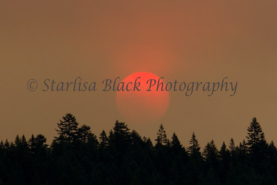sun seen through smoke during the Cascade Creek Fire near Mount Adams in 2012