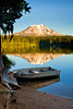 Vertical Takhlakh Lake and Boat  Mount Adams reflects in the popular camping and fishing lake in Gifford Pinchot National Forest in Washington State
