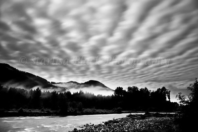 Moonlit clouds fan out at 3:00 am over the Cispus River near Randle, Washington