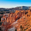 "Bryce Canyon is a small national park in southwestern Utah. Named after the Mormon Pioneer Ebenezer Bryce, Bryce Canyon became a national park in 1928.<br /> <br /> Bryce is famous for its worldly unique geology, consisting of a series of horseshoe-shaped amphitheaters carved from the eastern edge of the Paunsaugunt Plateau in southern Utah. The erosional force of frost-wedging and the dissolving power of rainwater have shaped the colorful limestone rock of the Claron Formation into bizarre shapes including slot canyons, windows, fins, and spires called ""hoodoos."" Tinted with colors too numerous and subtle to name, these whimsically arranged rocks create a wondrous landscape of mazes, offering some of the most exciting and memorable walks and hikes imaginable"