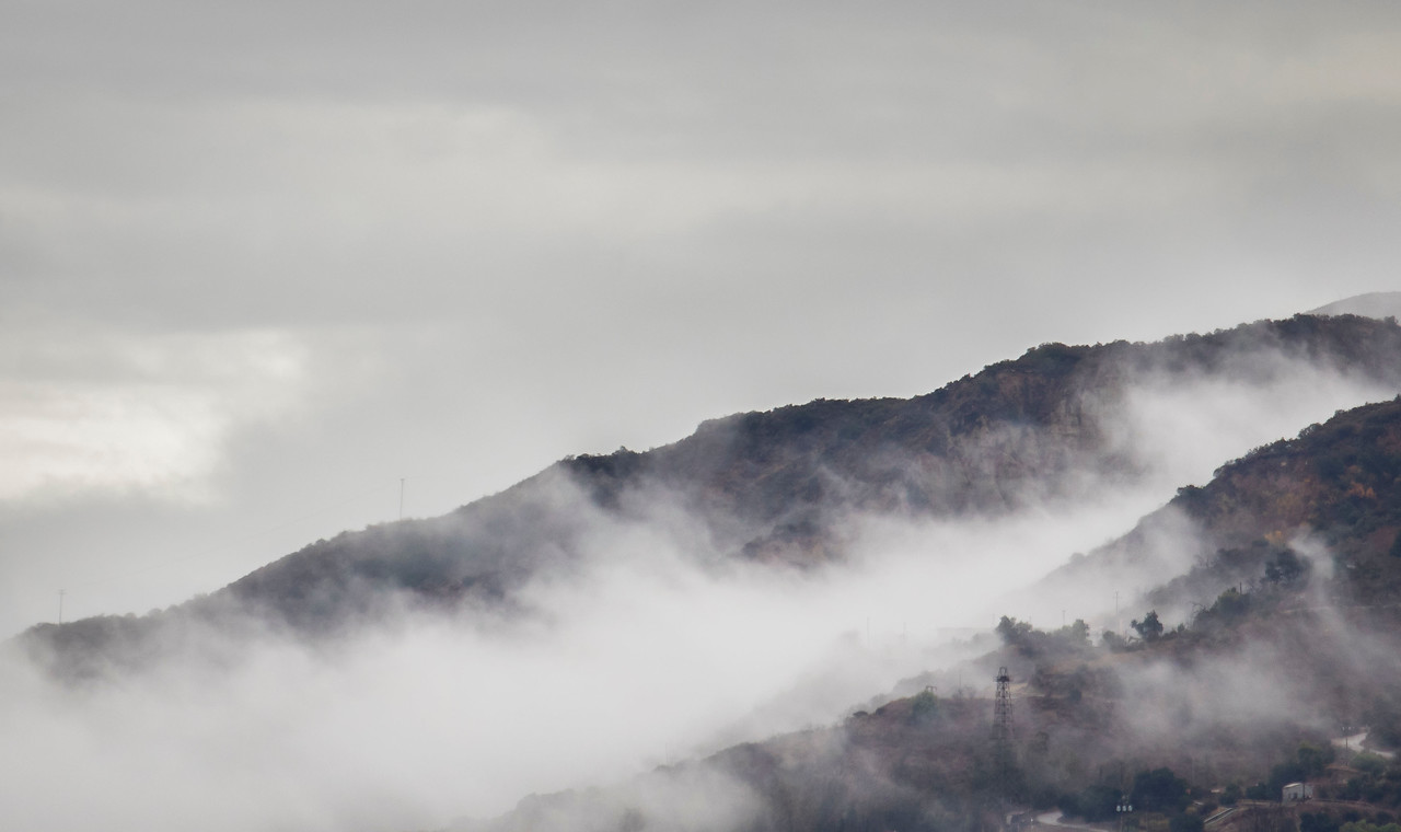 After a heavy down pour of rain, the fogs lifts from the mountains in Santa Paula, California. (© Erica Jacques 2016)