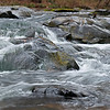 a brisk flow of water, over and around rocks at Turkey Creek