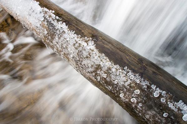 Frozen Log over a Waterfall