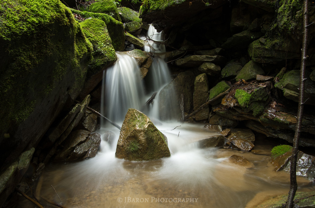 Flowing Water and Mossy Rocks